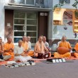 Members of Hare Krishna sit and sing on one of the central streets of Bratislava, Slovakia July 22, 2013 — Stock Photo #37389411