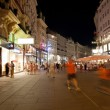 Stock Photo: Tourists walk at night in center of Vienna, Austria, July 27,2013