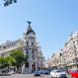Metropolis building situated on representative Gran Via street on September 24, 2013 in Madrid, Spain — Stock Photo