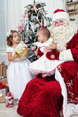 Saint Nicolas gives to small children Christmas gifts — Zdjęcie stockowe