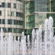 Fountains against mirror walls of the business center — Stock Photo #37779443