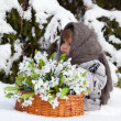 Little girl in a winter forest with the big basket — Stock Photo #37779479