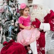 Little girl in a beautiful dress sits on a lap at Saint Nicolas — Stock Photo #37779483
