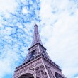 Eiffel Tower against the blue sky and clouds. Paris. France. — Stock Photo #40076341