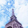 Eiffel Tower against the blue sky and clouds. Paris. France. — Stock Photo