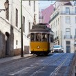 Yellow ancient tram on streets of Lisbon, Portugal — Stock Photo #40509305