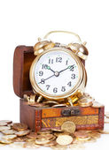 Gold alarm clock lay on money in a wooden chest — Stock Photo