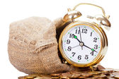 Great golden alarm clock faces on coins. Time is money — Stock Photo