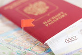 Passport with money lies on the tourist map — Stockfoto