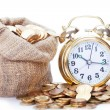 Great golden alarm clock faces on coins — Stock Photo