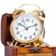 Gold alarm clock lay on money in a wooden chest — Stock Photo #44564589