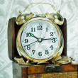 Alarm clock  stand on a chest with gold coins — Stockfoto #44564673