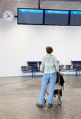 Woman at the airport — Stock Photo