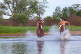 Young men gallop astride horses — Stock Photo