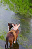 Man lies on grain of the horse — Stock Photo