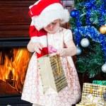 Little girl at a Christmas fir-tree — Stock Photo #7849456