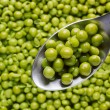 Spoon of Green Peas - Stock Photo