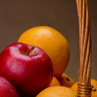 Fruit in a wicker basket — Stock Photo