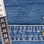 Denim and Measuring Tape — Stock Photo #13397433