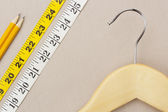 Hanger and Measuring Tape — Stock Photo