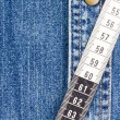 Measuring Tape on Denim — Stock Photo #13907175