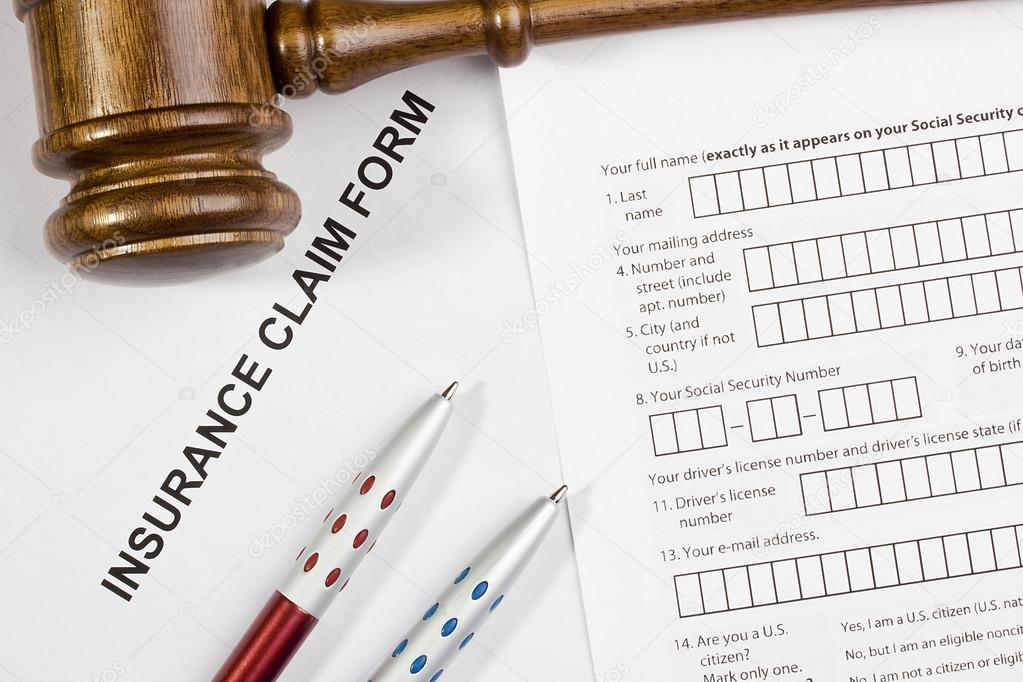 Directly above photograph of an insurance claim form. — Stock Photo #14635475