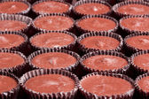 Milk chocolate cups — Stock Photo