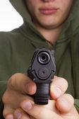 Man aiming a gun — Stock Photo