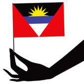 Antigua and Barbuda flag in his hand — Stock Vector