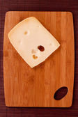 Cutting board and cheese — Foto Stock