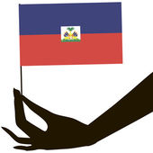 Hand with flag Haiti — Vetorial Stock