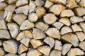Firewood stacked in the woodpile — Stock Photo