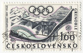 Sport in Grenoble Olympics on post stamp — Stock Photo
