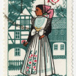 Young woman in traditional costume on post stamp — Stock Photo
