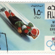 Toboggan at the Winter Olympics in Grenoble on postage stamp — Stock Photo