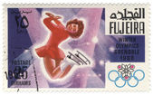Figure skating at the Winter Olympics in Grenoble on postage sta — Stock Photo