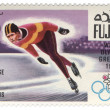 Постер, плакат: Running skater at the Winter Olympics in Grenoble on postage sta