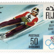 Descent to sledge at Winter Olympics in Grenoble on postage — Stock Photo #16932727