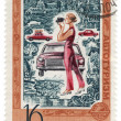 Foto Stock: Womwith camerand car on post stamp