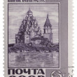 Old wooden church in Kizhi island (1714) on post stamp — Stock Photo