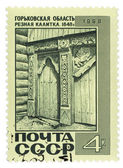 Old carved wooden gate on post stamp — Stock Photo