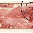 Royalty-Free Stock Photo: Mountain Lake Rizza in Caucasus on post stamp