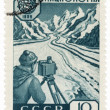Researcher glaciologist in a valley on post stamp — Stock Photo