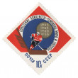 Ice hockey player with stick on post stamp — Stockfoto