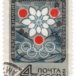 Symbolism of the Olympic Winter Games in Grenoble on post stamp — 图库照片