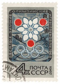 Symbolism of the Olympic Winter Games in Grenoble on post stamp — Stock Photo