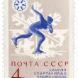 Running skater on post stamp - Stock Photo
