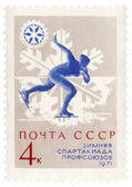 Running skater on post stamp — Stock Photo
