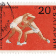Foto de Stock  : Wrestling on post stamp