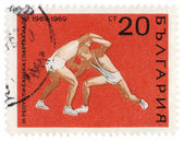 Wrestling on post stamp — Stock Photo